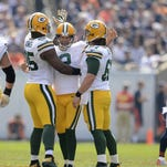 Green Bay Packers kicker Mason Crosby (2) is congratulated by teammates Datone Jones (95) and Brett Goode (61) after Crosby hit a 53-yard field goal in the third quarter during Sunday's game at Soldier Field in Chicago.
