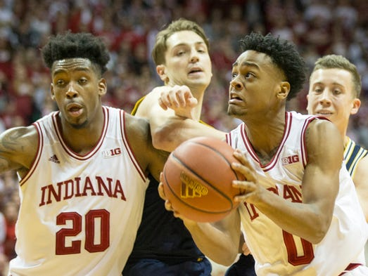 Curtis Jones looks for a shot for Indiana, as teammate