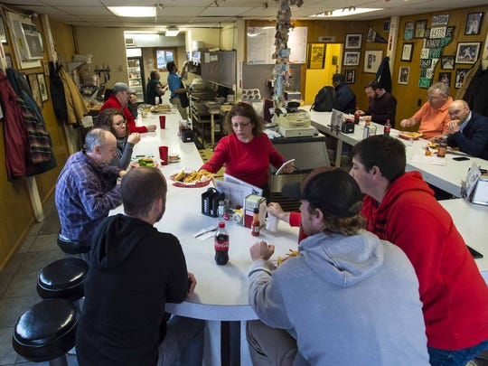 Mary Small brings out an order at Handy's Lunch in Burlington on Dec. 4, 2015.
