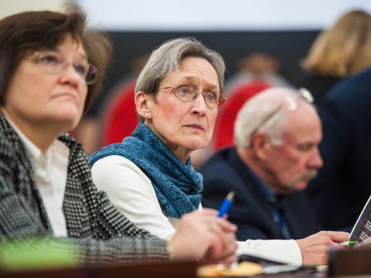 Rep. Maida Townsend, D-South Burlington, center, listens to a briefing for legislators on the state budget gap at the Statehouse in Montpelier on Wednesday, November 30, 2016.