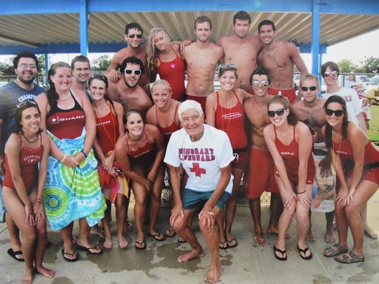 Lifeguards at the Mountain Home City Pool surround Jay Strauch, 84, in this 2011 photograph. The guards threw a surprise birthday party for Strauch and made him an honorary guard that year.