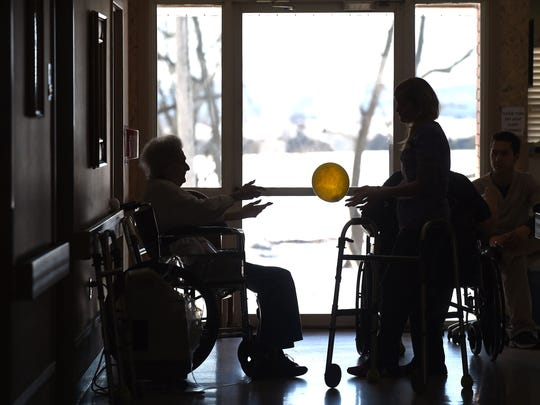 A physical therapist at Gassville Therapy and Living works with a resident on Thursday. Area nursing homes recently were graded by a government agency.