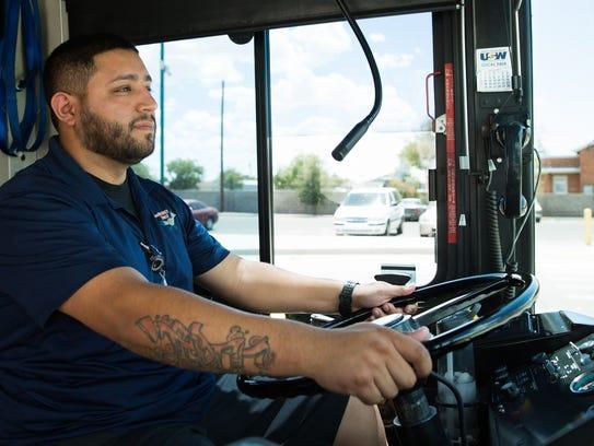 Roadrunner Transit bus driver Edwardo Tovar prepares
