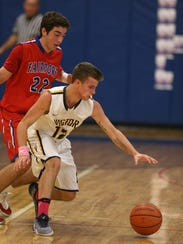 Victor's Jacob DiSanto (12) chases a loose ball with