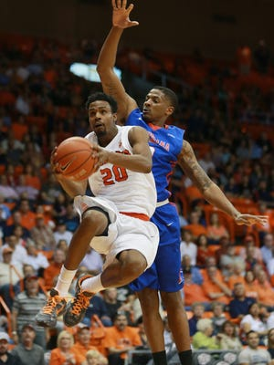 UTEP's Earvin Morris, with the ball, along with three of his senior teammates, will play their final regular season game on Saturday at the Don Haskins Center.