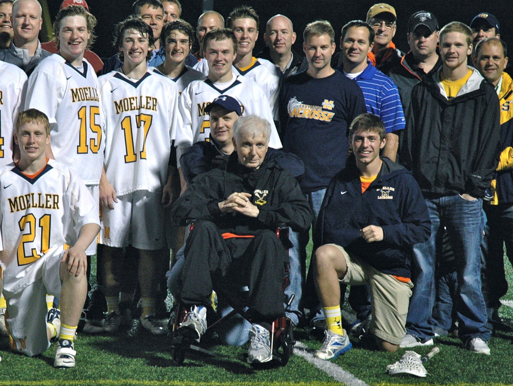 Tom Kennedy, surrounded by lacrosse players, family and friends, died in January. The Moeller lacrosse team will honor him May 9.