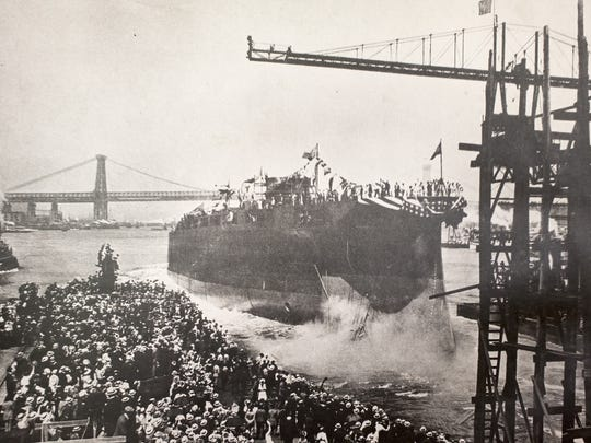 The USS Arizona is christened as a crowd watches on June 19, 1915, at the Brooklyn Navy Yard.