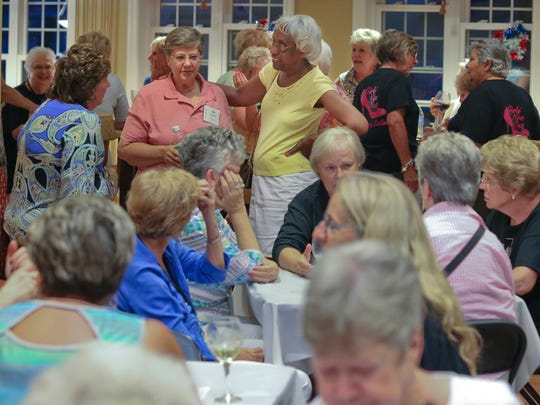 Residents and guests socialize during a women's gathering at the Legacy at Odessa National's community center.