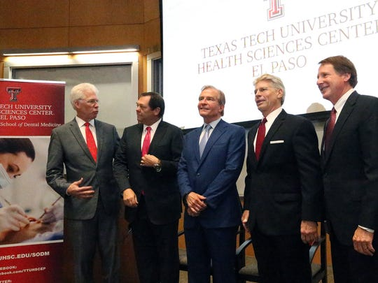 Dr.  Richard Lange, left, president of Texas Tech University Health Sciences Center El Paso, talks with El Paso businessman Paul L. Foster as they pose for photographs with El Paso businessman Woody L. Hunt, center, Texas Tech regent Rick Francis and Texas Tech University Chancellor Robert L. Duncan at an event announcing the establishment of the Woody L. Hunt School of Dental Medicine on Tuesday.