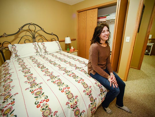 Julie Meyer, Sartell, sits in one of the bedrooms that