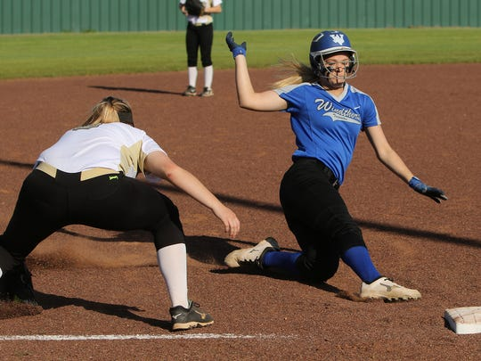 Windthorst's Tatum Veitenheimer slides into third in the game against Archer City Friday, March 17, 2017 in Archer City. The Lady Wildcats defeated the Trojanettes10-3.