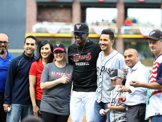 A group that threw the ceremonial pitches pose with pitcher Tyrell Jenkins, center, Thursday night at Southwest University Park.