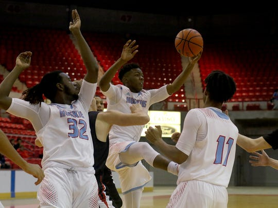 Hirschi's Mark Harrell grabs the rebound in the game