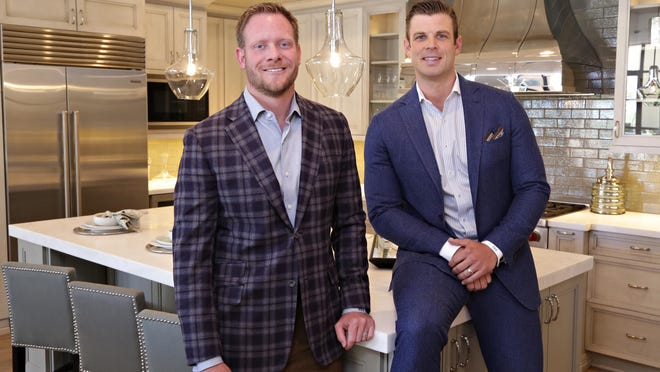 Nathan Day, l, and Tanner Luster, CEO, and President respectively, of Cypress Development, in a model kitchen of their Sterling Collection at Silverleaf project near DC Ranch as seen in Scottsdale on May 18, 2015