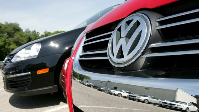 """A Volkswagen Jetta sits on the lot in Indianapolis. The first """"Dieselgates"""" suits have been filed by local residents over the automaker's """"clean diesel"""" claims."""