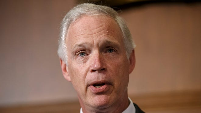 Sen. Ron Johnson, R-Wis., announces that he has filed a lawsuit to block the federal government from helping to pay for health care coverage for members of Congress and their staffs, during a news conference on Capitol Hill in Washington, Monday, Jan. 6, 2014. Johnson says that members of Congress and their staffs are getting special treatment under the health care law. The lawsuit would would force Congress and its staffers to purchase their insurance from the federal health care exchanges without exemptions carved out by the Office of Personnel Management. (AP Photo/J. Scott Applewhite) ORG XMIT: DCSA105