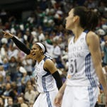 Minnesota Lynx forward Maya Moore, center, celebrates with her team after a foul was called against the Phoenix Mercury during the second half of the Sept. 24 game in Minneapolis. The Lynx won 67-60.