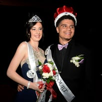 Hannah Deaton, left, and Torrie Mayberry pose together Saturday, April 30, 2016, after being announced as king and queen of the Richmond High School prom in the Tiernan Center at Richmond High School.