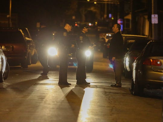 Wilmington police investigate in the first block of E. 23rd St. after a report of a shooting shortly before 11 p.m. Friday.