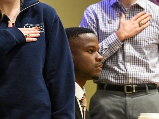 Vice President Jaren Stewart, sits between Secretary Kara Donovan, left, President Leland Dunwoodie, middle, for the Pledge of Allegiance during the Clemson Undergraduate Student Senate meeting in the Student Union in Clemson on Monday.