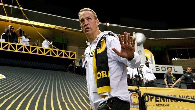 Denver Broncos quarterback Peyton Manning (18) walks into the stadium during Super Bowl 50 Opening Night media day at SAP Center.