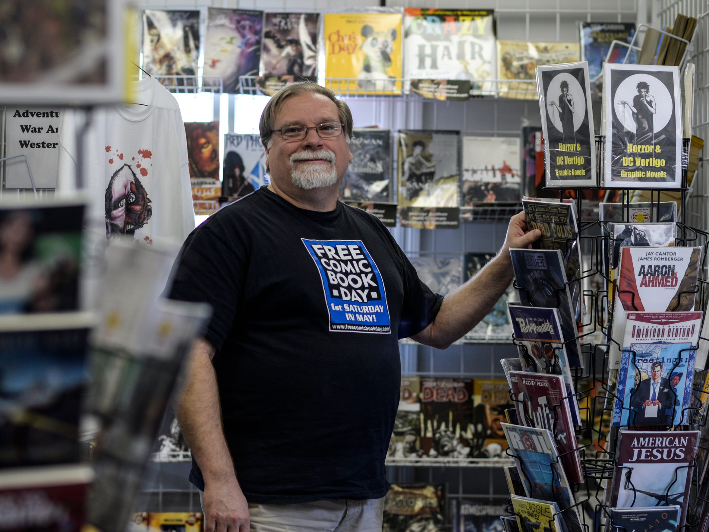 Ralph Watts, owner of Comics and Paperbacks Plus, poses for a photo at Comics and Paperbacks Plus in Palmyra.