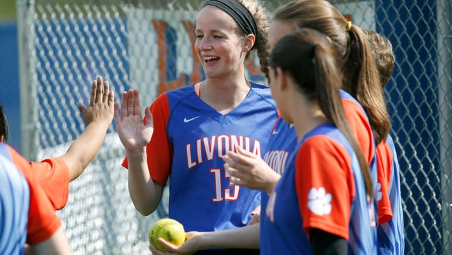 Livonia softball pitcher Molly Stewart who overcame a serious fall as a child, is a star athlete seen here during a game against Bath.