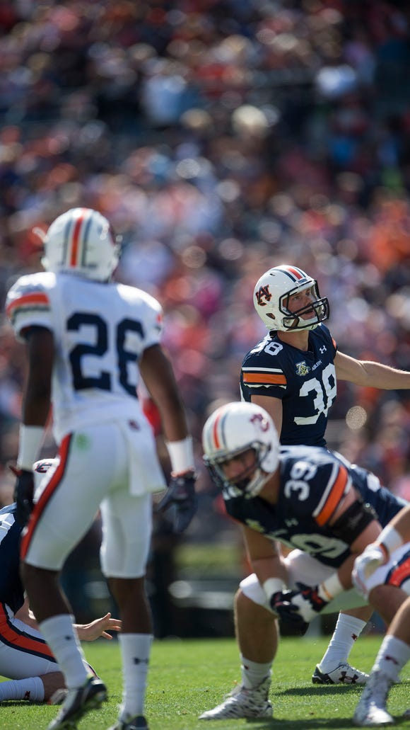 Auburn kicker Daniel Carlson (38) watches a field goal