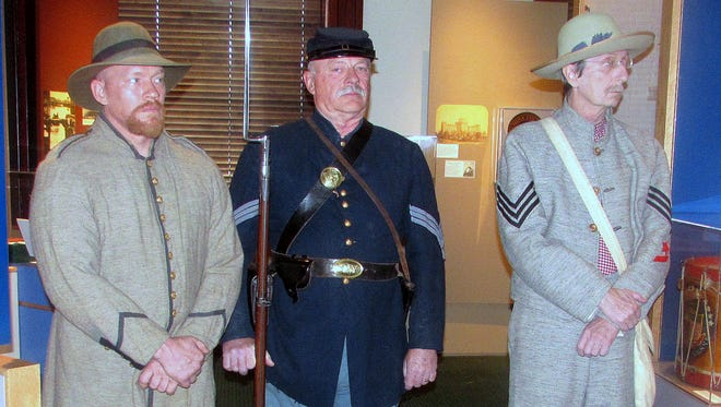 Civil War re-enactors, from left, Doug Oakes, Douglas Oakes Sr. and Bob Roe take part in a news conference Wednesday regarding the future of the Elmira Civil War prison camp.