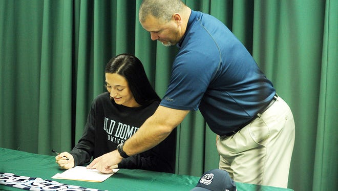 Parkside High's Blair Vilov, with counselor Brian Hollamon, signs her National Letter of Intent with Old Dominion University on Wednesday, Feb. 1, 2017 in Parkside's library.