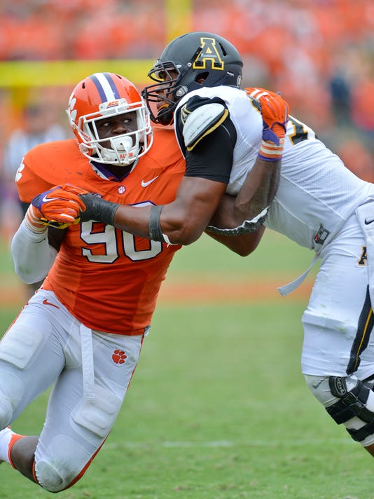 FILE - In this Saturday, Sept. 12, 2015, file photo, Clemson's Shaq Lawson (90) works against Appalachian State's Davante Harris during the second half of an NCAA college football game in Clemson, S.C. Lawson has been named to the AP All-America football team. (AP Photo/Richard Shiro, File)
