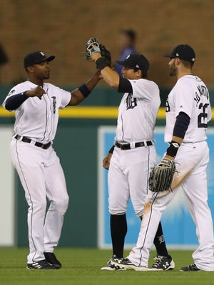 (From left) Tigers leftfielder Justin Upton, centerfielder Mikie Mahtook and rightfielder J.D. Martinez celebrate the Tigers' 5-3 win over the Royals Tuesday at Comerica Park.