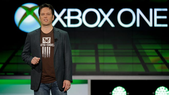 In this June 10, 2013 file photo, Phil Spencer of Microsoft Game Studios speaks at the Microsoft Xbox E3 media briefing in Los Angeles.