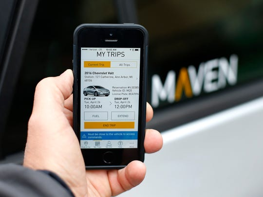A smartphone displaying the Maven app, a GM car-sharing service, is shown in Ann Arbor in April 2016. GM launched its Maven car-sharing service in New York on Monday, May 15, 2017. The service lets members rent a variety of GM vehicles for whatever they need, from a 30-minute errand to a 28-day road trip.