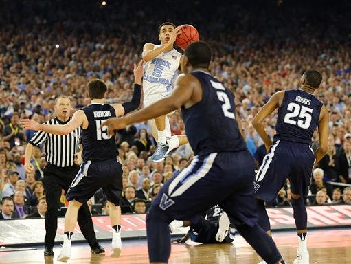 North Carolina guard Marcus Paige (5) shoots against Villanova during the second half of the NCAA Final Four tournament college basketball championship game Monday, April 4, 2016, in Houston.