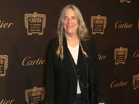 "FILE - In this Sept. 7, 2016 file photo, Patti Smith attends the Cartier Fifth Avenue Mansion grand reopening celebration in New York. Smith says that when she stumbled over the lyrics of a Bob Dylan song during the Nobel Prize ceremony last week, it was because she was overwhelmed with nerves by the enormity of the experience, not because she forgot the words to ""A Hard Rain's A-Gonna Fall."" Smith writes in an essay published Wednesday, Dec. 14, 2016, by the New Yorker that after loving the song since she was a teenager and rehearsing it incessantly in the months and days leading up to the ceremony, its lyrics ""were now a part of me."""