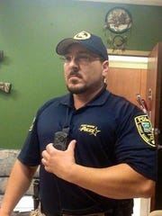 Port Barre Police Chief Deon R. Boudreaux shows off one of the new combination body cameras and police radios that have been issued to all his officers.