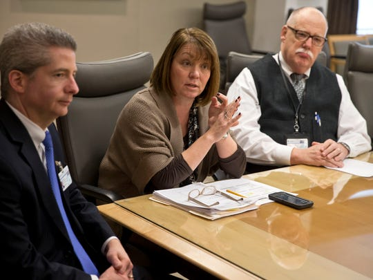CentraState Medical Center is trying to cut down on the high rate of its patients who get sick or hurt in the hospital. Officials talk about the training they have received. Cathleen Janzekovich, assistant vice president of nursing at Freehold Township's CentraState Medical Center, talks while Thomas W. Scott, senior vice president and chief operating officer (left), and Carl Ausfahl, assistant vice president of quality and performance improvement listen.