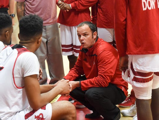 Vero Beach coach Shane Whitsett, going over instructions with his team during a timeout against Treasure Coast Tuesday, Jan. 9, 2018 at  the John B. Witt Gym, has guided the Fighting Indians to six consecutive wins.