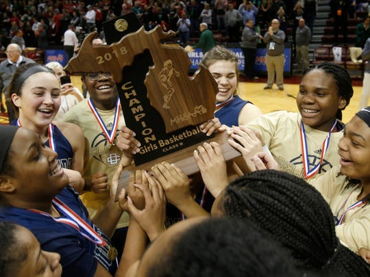 Detroit Country Day players celebrate their 64-48 win over Jackson Northwest at the MHSAA Class B girls state basketball finals at Van Noord Arena at Calvin College in Grand Rapids, Michigan on Saturday, March 17, 2018. Country Day won the game and the Class B state title 64-48.
