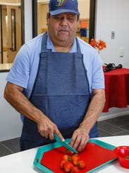 Elizar Cano attends the first cooking class in the