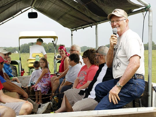 Carl Van Meter shares stories with visitors Saturday, Sept. 5, during a tractor-drawn wagon tour on his buffalo ranch in the White County town of Buffalo. This marks the 11th consecutive Labor Day weekend he and his wife, Zona, have hosted the tours.