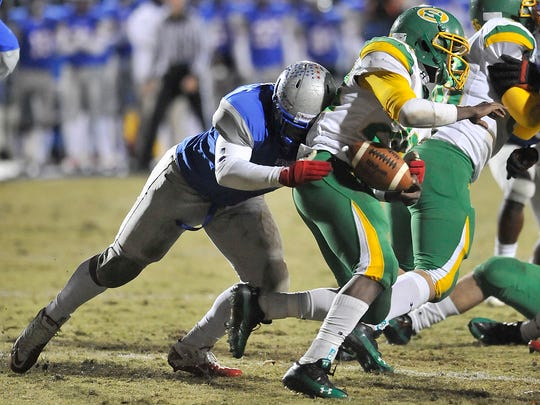 Byrnes defensive lineman Rashad Dillard (44) knocks the ball out of the hands of a Summerville running backs hands  late in the second quarter in Class AAAA Division I second-round high school football action in Duncan on Friday, November 18, 2011.