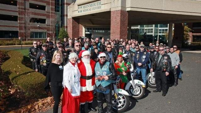 Ashley Boyd, development manager with Monmouth Medical Center Foundation welcomes Santa, Mrs. Claus, the Long Branch Police Department and the Blue Knights to The Unterberg Childrens Hospital at Monmouth Medical Center as part of the Toy Run on November 8.