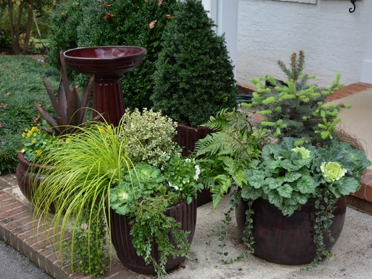 Colors and textures in these porch pots are carefully coordinated so they work in harmony.