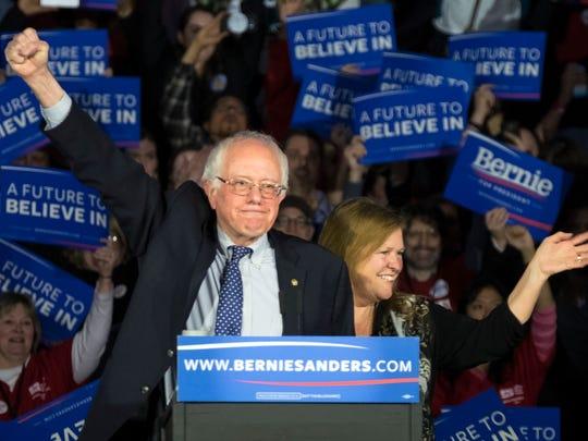 Sen. Bernie Sanders and his wife, Jane, acknowledge
