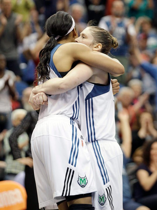Minnesota Lynx forward Maya Moore, left, and guard Lindsay Whalen, right, celebrate on the court in the second half of a WNBA basketball game against the Los Angeles Sparks, Tuesday, July 8, 2014, in Minneapolis. The Lynx won 83-72. (AP Photo/Stacy Bengs)