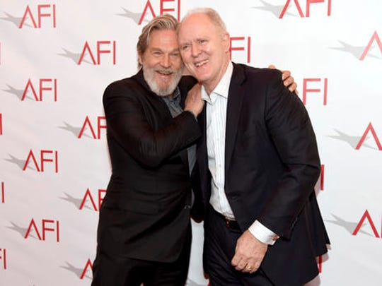 Jeff Bridges, left, and John Lithgow arrive at the AFI Awards at the Four Seasons Hotel on Friday, Jan. 6, 2017, in Los Angeles.