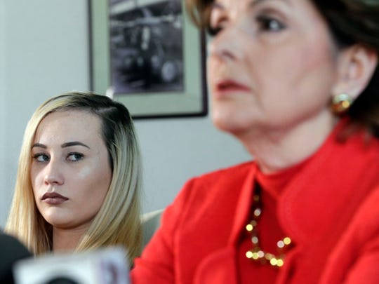 Active-duty Marine Marisa Woytek, left, and attorney Gloria Allred announce that photos of her and another former female Marine were secretly posted online without their consent, at a news conference in Los Angeles Wednesday, March 8, 2017. Nude photos of other servicewomen were also posted. Gen. Robert Neller, the Marine Corps commandant, has condemned the photo sharing and urged victims to report abuse.