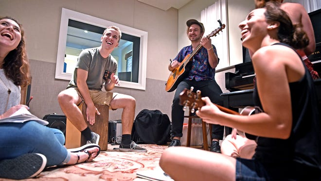 Lipscomb students Chelsey Sutton, Luke Summer, Nordista Freeze and Lauren Domasig have an impromptu jam session inside a new studio at Lipscomb.  Lipscomb has renovated a house near campus to resemble the home recording studios that are common on Music Row.